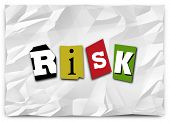 Risk word cut out magazine letters piece paper ransom note warn you security danger threat