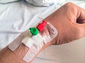 foto of intravenous  - Intravenous cannula venflon inserted on man - JPG