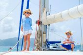 Kids enjoying sailing on a luxury catamaran or yacht