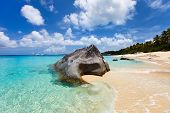 Beautiful tropical beach with white sand, turquoise ocean water and blue sky at Virgin Gorda, Britis