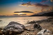 Sunset sky over a rocky seashore, Croatia, Europe.