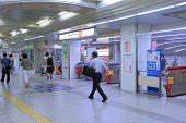 Commuters at subway station Osaka Japan.