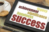 success components - happiness, significance, achievement, legacy on a digital tablet with a cup of