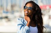 beautiful young african woman wearing sunglasses