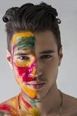 Head-shot Of Attractive Young Man, Skin Painted With Holi Colors