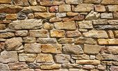 pic of gneiss  - Colorful stone wall closeup in sunny day - JPG