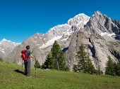Hiker admiring mountain landscape around Mont Blanc, Courmayer, Italy, Europe.