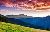 Mountains glow by sunlight. Morning overcast sky. Dramatic scenery. Carpathian, Ukraine, Europe. Bea