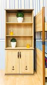 Beautiful wooden cupboard in children's room