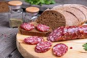 Salami And Bread On The Kitchen Table