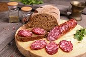 Salami And Bread On A Cutting Board
