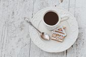 picture of mood  - Shabby chic style coffee cup and plate with gingerbread house cookie cinnamon sticks and other decorations for Christmas mood - JPG