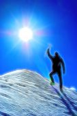 Climber reaching the summit of a mountain. Stylized silhouette with fantasy-painting effect.