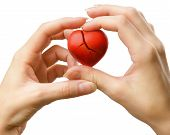 Broken Red Heart In Hands