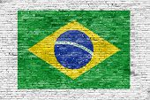 Flag Of Brazil Painted On White Brick Wall
