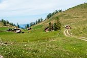 Some Wooden Huts In The Alps