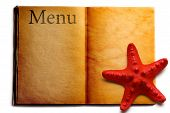 Open Menu Book And Red Seastar
