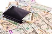 dollar bills and purse
