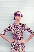 Fashion And People Concept - Pretty Sexy Woman In Leopard Dress And Sunglasses Posing Outdoors In Ur