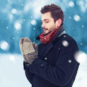 Handsome Man In Mittens Freezes Outdoors In Winter Snowy Day