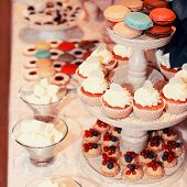 Sweet Colorful Buffet Table With Macaroons And Cakes