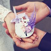 Wedding Floral Lock Closeup In Hands Bride And Groom