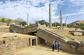 Tourists explore famous collapsed obelisks of Axum, Ethiopia.