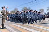 Company of traffic police officers march on parade
