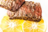 Sliced Fried Meat With Slices Of Lemon Closeup