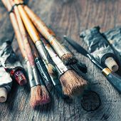 Artistic Paintbrushes, Tubes Of Oil Paint, Palette Knife On Old Wooden Desk.