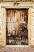 Old vintage brown wood spanish door