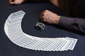 Dealer Spreading The Deck At Poker Game