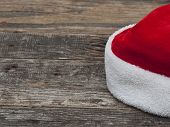 Santa hat on wooden table with copy space