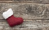 Santa or christmas boot on a wooden background for a greeting card