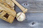 Old Baseball Equipment On Aged Wood