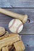 Old Baseball Items On Rustic Wood