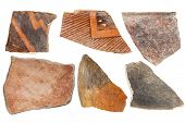 ancient Native American Indian (Anasazi) artifacts, six pottery shards  isolated on white