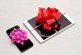 Tablet and Cell Phone Wrapped with Gift Bows