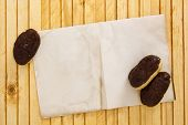 stock photo of pastarelle  - Mini eclairs on a wooden background with a sheet of paper for information - JPG