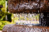 Water Dropping From a Fountain