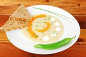 homemade cuisine : salmon vegetable soup with bread and chives over wood