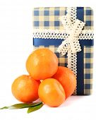 Tasty mandarins and gift box isolated on white