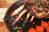 grilled meat ribs ready to eat with vegetables