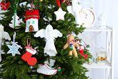 Christmas handmade decorations on Christmas tree  on light background