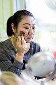 Portrait Of Asian Beautiful Woman With Brush For Make-up