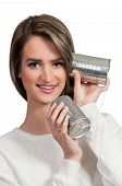 foto of tin can phone  - Woman talikng on a primative tin can phone - JPG