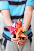 Bouquet of origami tulips in children's hands