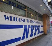 Sign at the famous NYPD Times Square Precinct in Midtown Manhattan