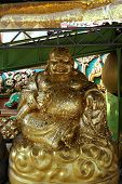 foto of gautama buddha  - happy Buddha statue represent of lucky and wealthy - JPG