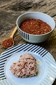 Brown Rice On Wooden Table